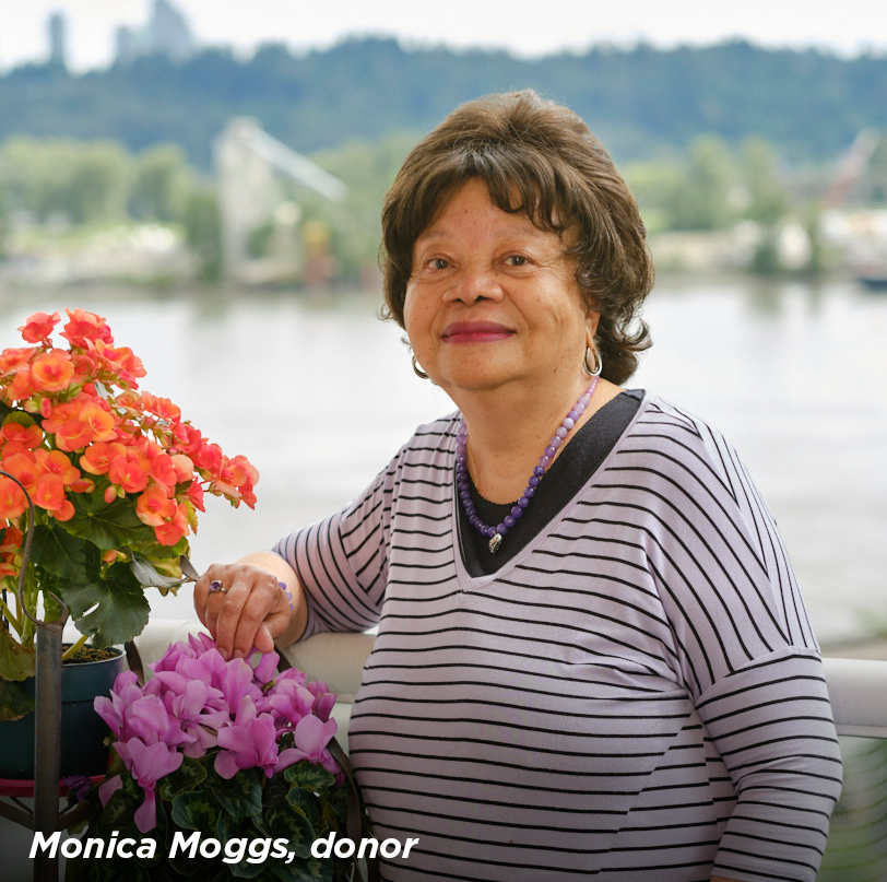 Monica Moggs, a legacy donor to Royal Columbian Hospital Foundation, standing next to some flowers